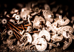 A pile of rusted plastic gears