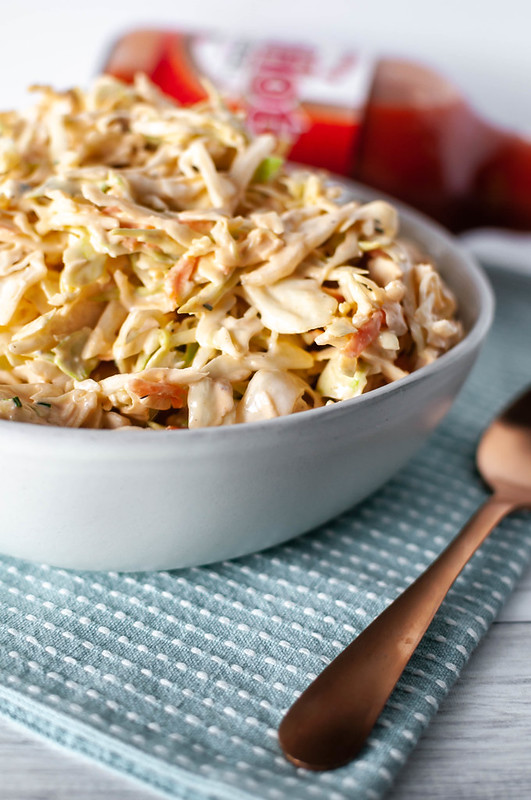 A classic American dish and a favorite flavor combine into one crazy delicious side dish. Buffalo Chicken Coleslaw is super creamy, slightly spicy and tangy and perfect for your next summer potluck.