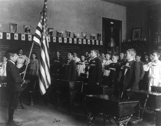 Students pledging to the flag on Flag Day 1899, 8th Division, Washington, D.C. Part of the Frances Benjamin Johnston 1890 - 1900 Washington, D.C., school survey.
