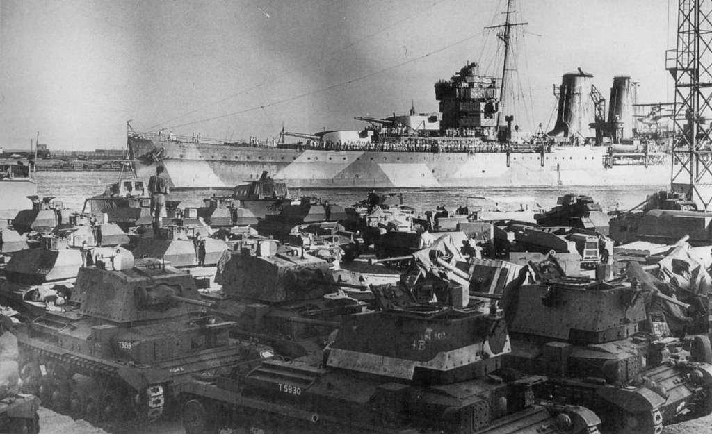 HMS York in the port of Alexandria. On the coast are unloaded from transports, cruisers tanks Mk II and Mk IVA