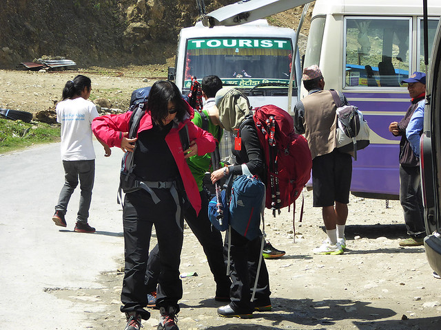 Adventurous travellers with backpacks getting ready to walk one of the Nepali walkingtrails.