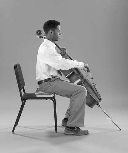 photo of cellist sitting tall