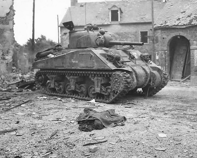 Body_of_Civilian_by_US_M4_Sherman_Tank_in_Canisy_France_1944