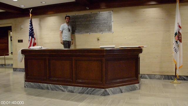 Matt Maldre standing next to pencil rubbing in Tribune Tower lobby