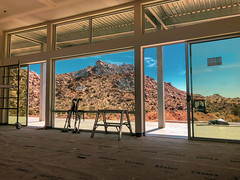 Framing a view of the desert in glass and steel