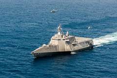 PACIFIC OCEAN (June 28, 2018) An MQ-8C Fire Scout unmanned helicopter conducts underway operations with an MH-60S Seahawk helicopter and the Independence-variant littoral combat ship USS Coronado (LCS 4). The new Fire Scout variant is expected to deploy with the LCS class to provide reconnaissance, situational awareness, and precision targeting support. Coronado is working with Air Test and Evaluation Squadron 1 (VX-1) to test the newest Fire Scout unmanned helicopter. Coronado is one of four designated test ships in the LCS class assigned to Littoral Combat Ship Squadron ONE. (U.S. Navy Photo by Mass Communication Specialist 2nd Class Jacob I. Allison/RELEASED)