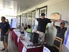 Hawaiian Electric's 2018 AUW Golf Tournament – June 11, 2018: VP of Power Supply Bob Isler measures a length of raffle tickets using his arms. Purchasing an amount of tickets measuring Bob's wingspan at a discount price was one of the options.