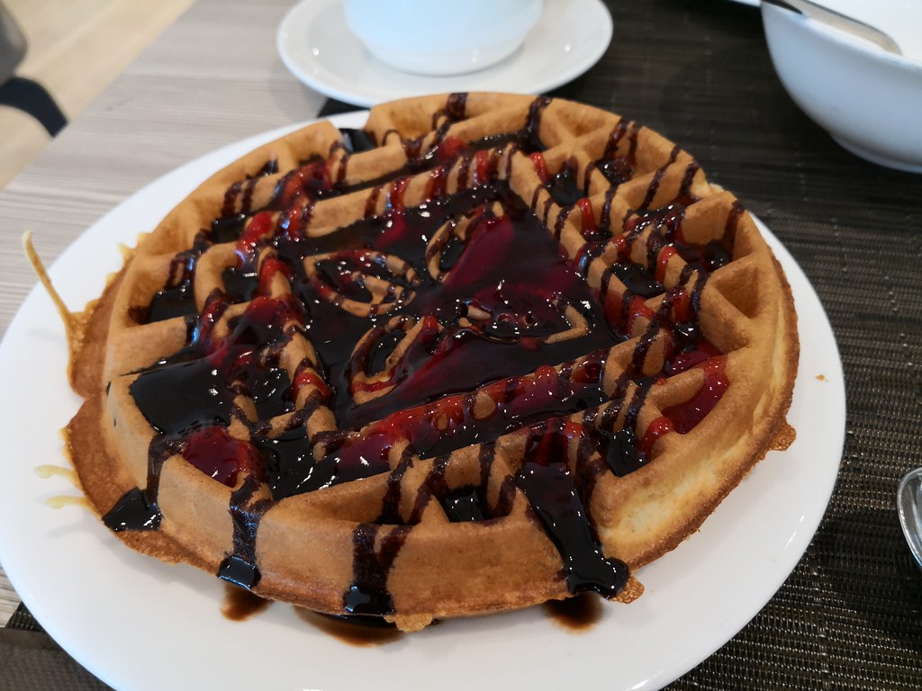 Waffles with chocolate syrup