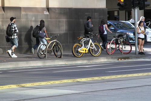 oBikes chained up to a bike rack at William and Little Bourke Street