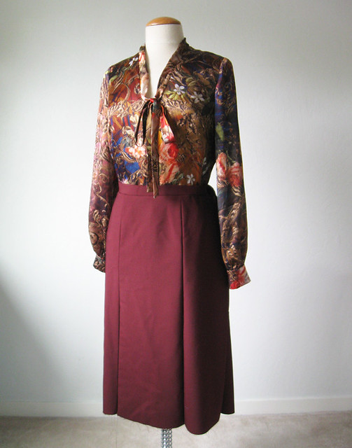 silk tie blouse and maroon wool skirt
