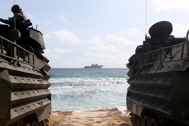 MARINE CORPS BASE HAWAII (July 10, 2018) U.S. Marines with Combat Assault Company, 3rd Marine Regiment, stage AAV-P7/A1 assault amphibious vehicles at Pyramid Rock Beach prior to embarking onto the Royal Australian Navy landing helicopter dock shop HMAS Adelaide (L01) as part of Rim of the Pacific (RIMPAC) exercise on Marine Corps Base Hawaii. RIMPAC provides high-value training for task-organized, highly capable Marine Air-Ground Task Force and enhances the critical crisis response capability of U.S. Marines in the Pacific. Twenty-five nations, 46 ships, five submarines, about 200 aircraft and 25,000 personnel are participating in RIMPAC from June 27 to Aug. 2 in and around the Hawaiian Islands and Southern California. The world's largest international maritime exercise, RIMPAC provides a unique training opportunity while fostering and sustaining cooperative relationships among participants critical to ensuring the safety of sea lanes and security on the world's oceans. RIMPAC 2018 is the 26th exercise in the series that began in 1971. (U.S. Marine Corps photo by Sgt. Zachary Orr)