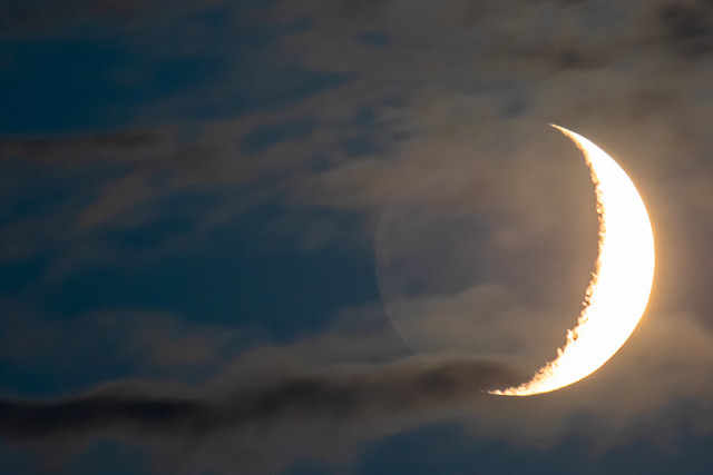 Moonset with partial cloud cover.