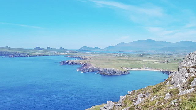 Blue ocean and rocky coastline at Clogher Head, Dingle Peninsula, Ireland.