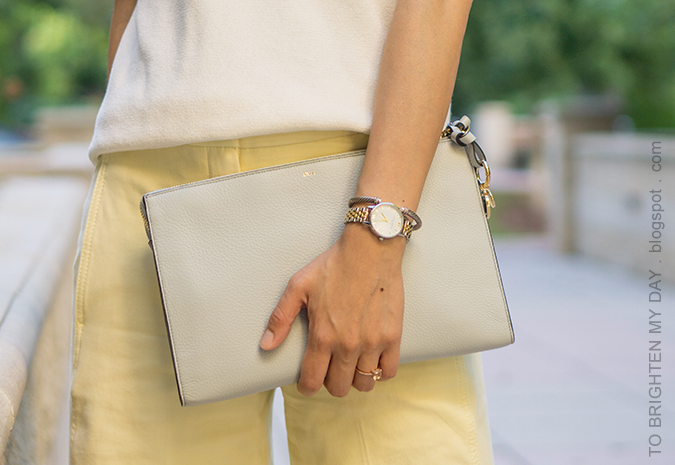 white sweater tee with fringe, two tone watch, silver cuff, morganite ring, yellow cropped wide legged pants
