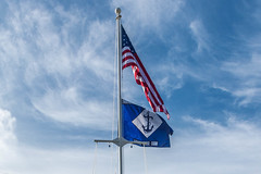 The 30th Naval Construction Regiment (NCR) command flag flies above the command's new headquarters in Guam, July 1. (U.S. Navy/MCC Matthew R. White)