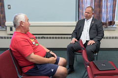 State Rep. Craig Fishbein talks with a concerned resident before the start of a town hall meeting in Cheshire. The meeting, hosted by Rep. Fishbein and State Sen. Suzio, was attended by about 20 people  who discussed various topics, including the state budget deficit.