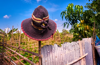 Knitted hat hanging on a bamboo fence in rural Cambodia