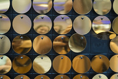 Gold discs reflection.