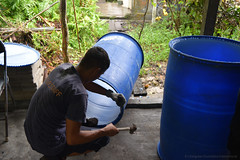 Enrichment team member modifying a barrel for enrichment installation