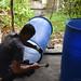 Enrichment team member modifying a barrel for enrichment installation