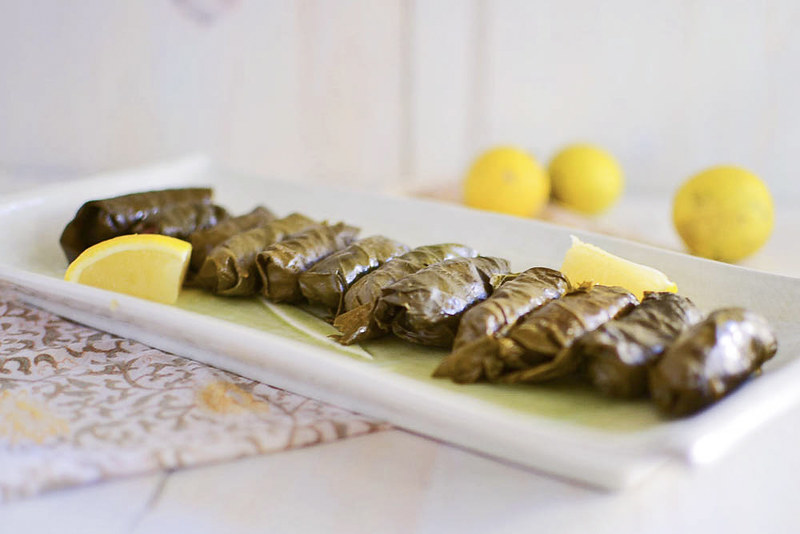 A step by step guide on making my mom's Turkish stuffed grape leaves recipe . Simply filled with rice, ground beef and layered with fresh lemon.