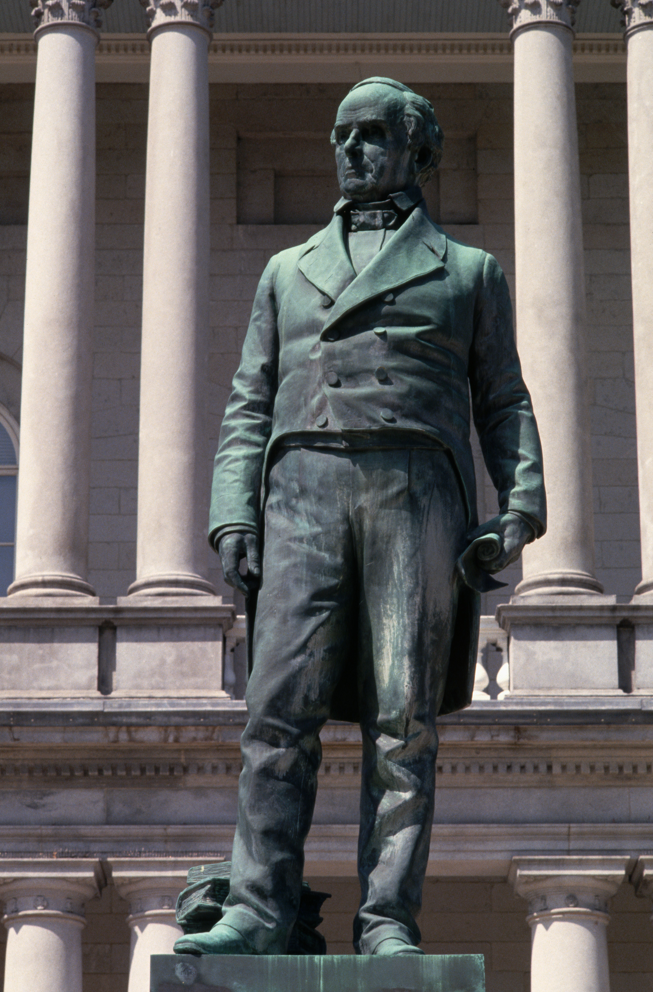 A statue of politician and orator Daniel Webster stands in front of the State House in Concord, New Hampshire.