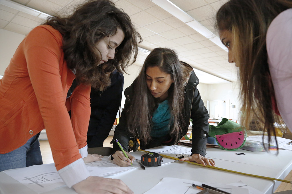 Richa Gupta (M.R.P. '18) center, works on design plans for the MUCC with Lama Shehadeh (M.R.P. '19), left, and Najila Ahsan (B.S. URS '19).