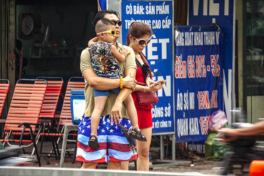 Man in American flag shorts--Saigon