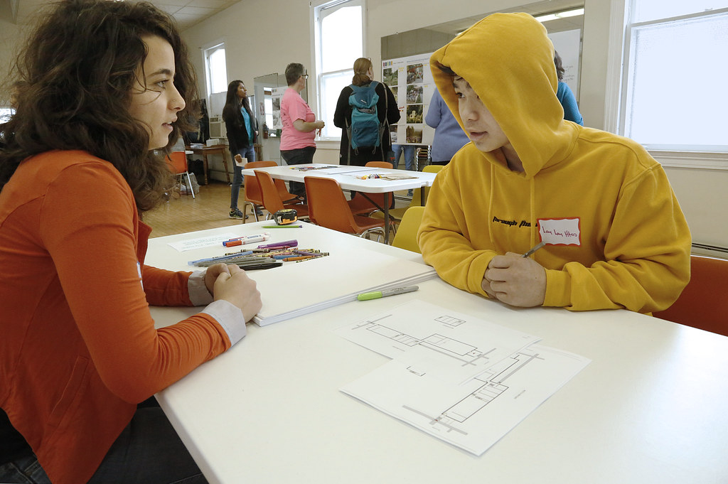 Lama Shehadeh (M.R.P. '19), left, shares an interactive exercise with a community member.