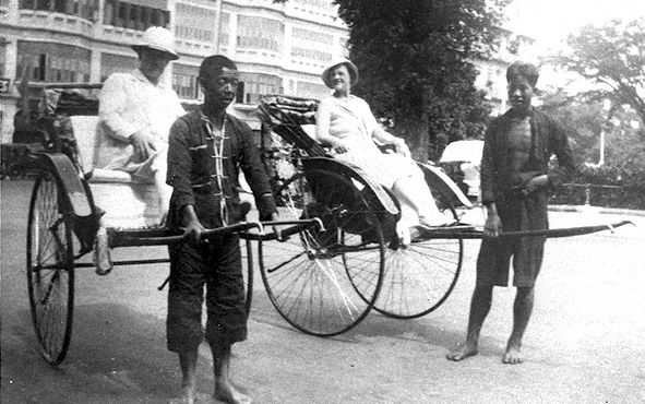 Jinrickshaw pullers with passengers in Singapore during the 1930s