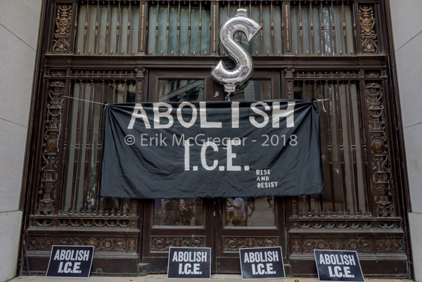 Activists protest Wall Street businesses profiting from ICE