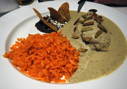 A nutty Mole de Pipian (made with pumpkin seeds), served up with Spanish rice in Puebla, Mexico