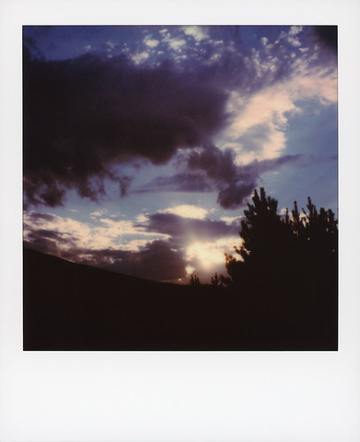 polaroid originals color 600 instant film slr680 polarado sunset county road 53 granby colorado co clouds cloudporn blue sky sunbeam pine tree silhouette polaradoone 072418 toby hancock photography