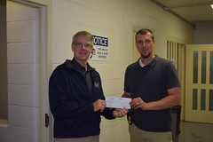 Rep. Ackert makes a donation to the Vernon Police Department to help in their annual Special Olympics fundraiser.