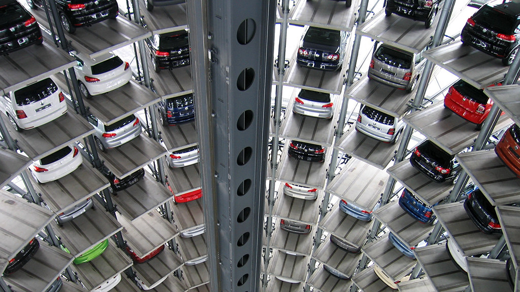 Cars being stored in a modern automotive factory.