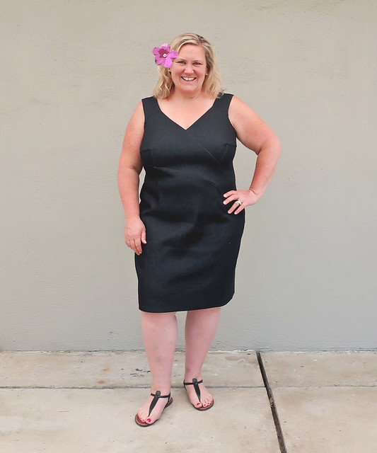 H black denim dress front view with flower