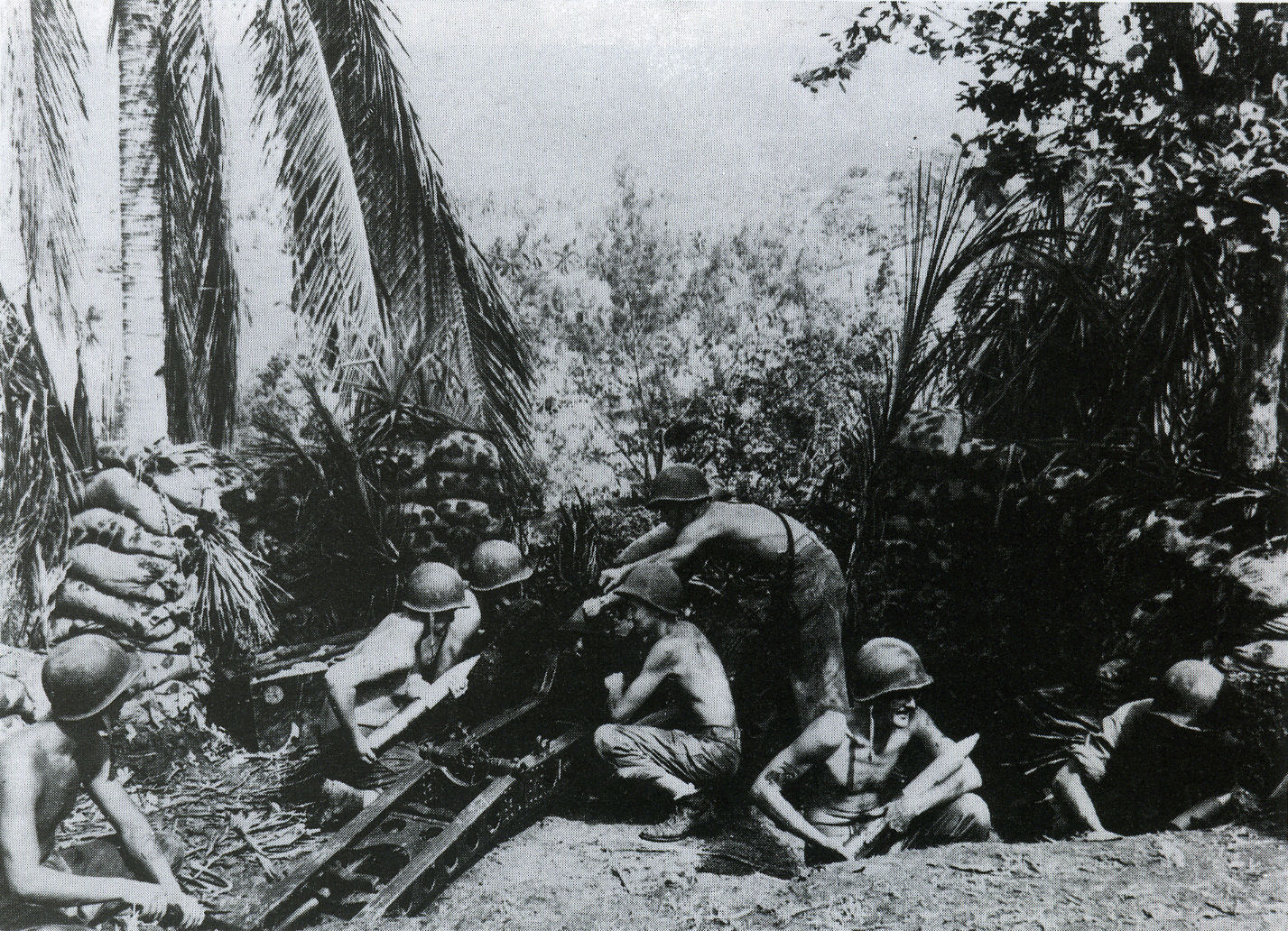 A U.S. 11th Marines 75mm pack howitzer and crew on Guadalcanal, September or October, 1942. The lean condition of the crewmembers indicate that they haven't been getting enough nutrition during this period.