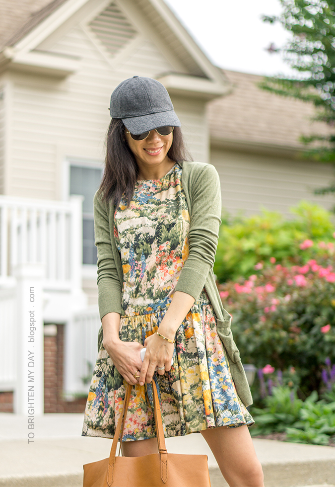 gray baseball cap, watercolor floral drop waist dress, green long cardigan, gold bangle, cognac brown tote