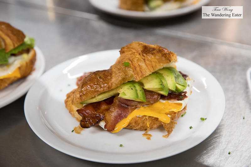 Avocado, bacon, cheese and egg croissant sandwiches on the pass