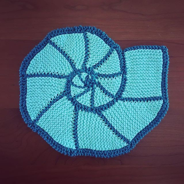 Ammonite hotpad. First attempt at the pattern. The middle is a little wonky and my stitch count is off but I think I have the hang of it now. More ammonites to come... #knitting #ammonite #dishcloth #hotpad
