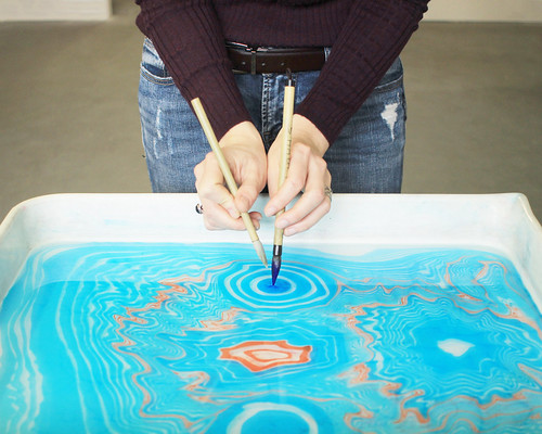 In the process of Suminagashi marbling paper for book covers. Artist Crystal Shaulis, Lake Michigan Book Press