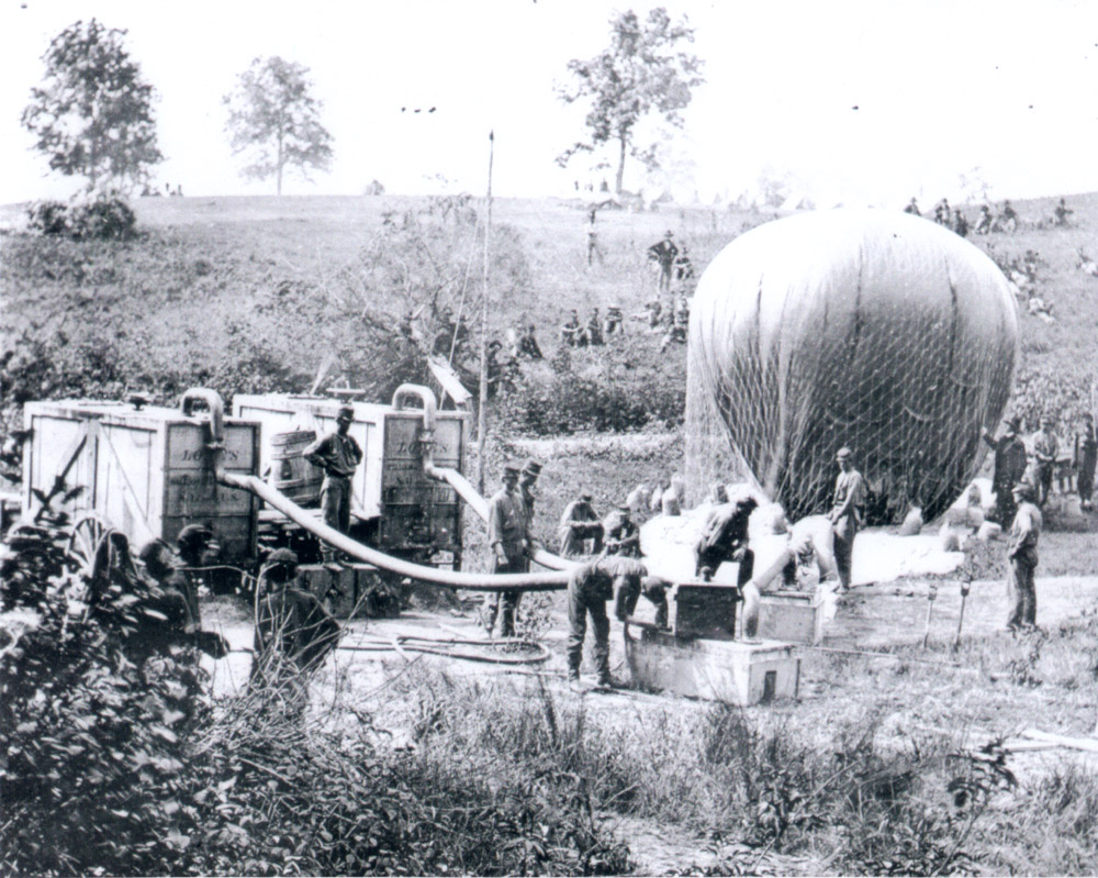 Union Army Balloon Corps ground crew working on aeronaut Thaddeus Lowe's balloon near Gaines Mill, Virginia, on June 1, 1862. Photo by Mathew Brady. From the collection of the Library of Congress.