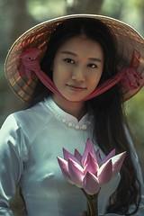 asian woman lotus credit to https://1dayreview.com