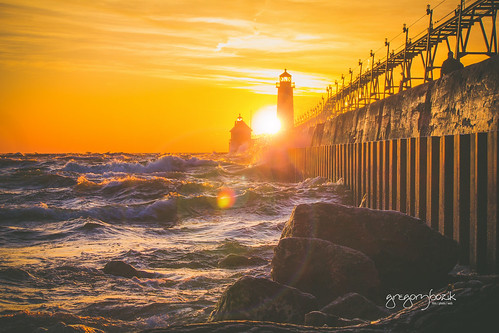 Sunset on Lake Michigan, Grand Haven lighthouse. Photographer Gregory Bozik