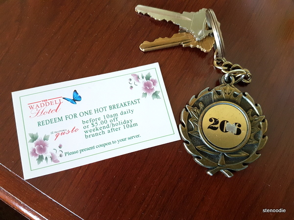 hotel keys and breakfast coupon