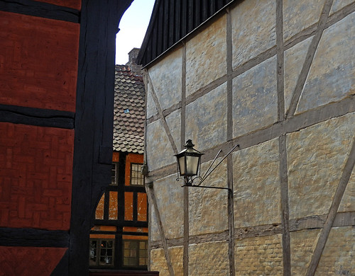 The lantern on a half-timbered wall in the village Den Gamle By, recreated villages set in different times, in Aarhus, Denmark