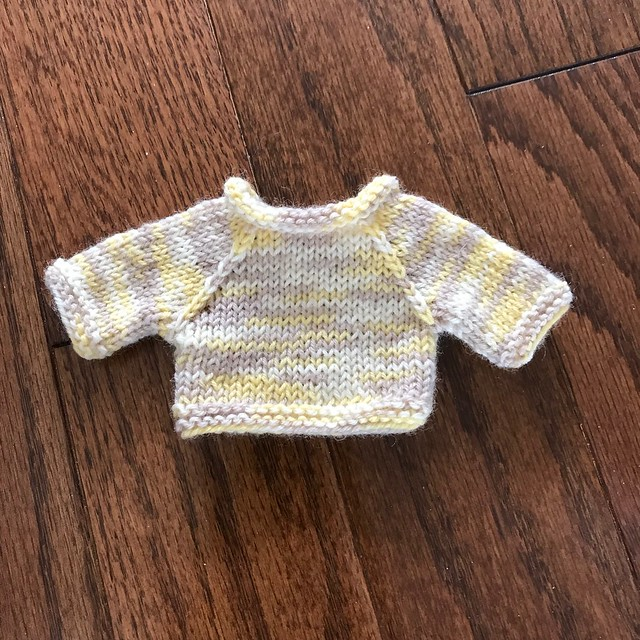 The adorable little sweater I decided to knit Oliver, the little Rabbit I knit Caleb to match his new Onesie!