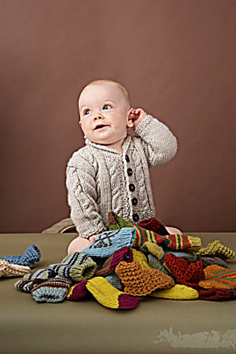 Heirloom Cables Baby Sweater by Lion Brand Yarn