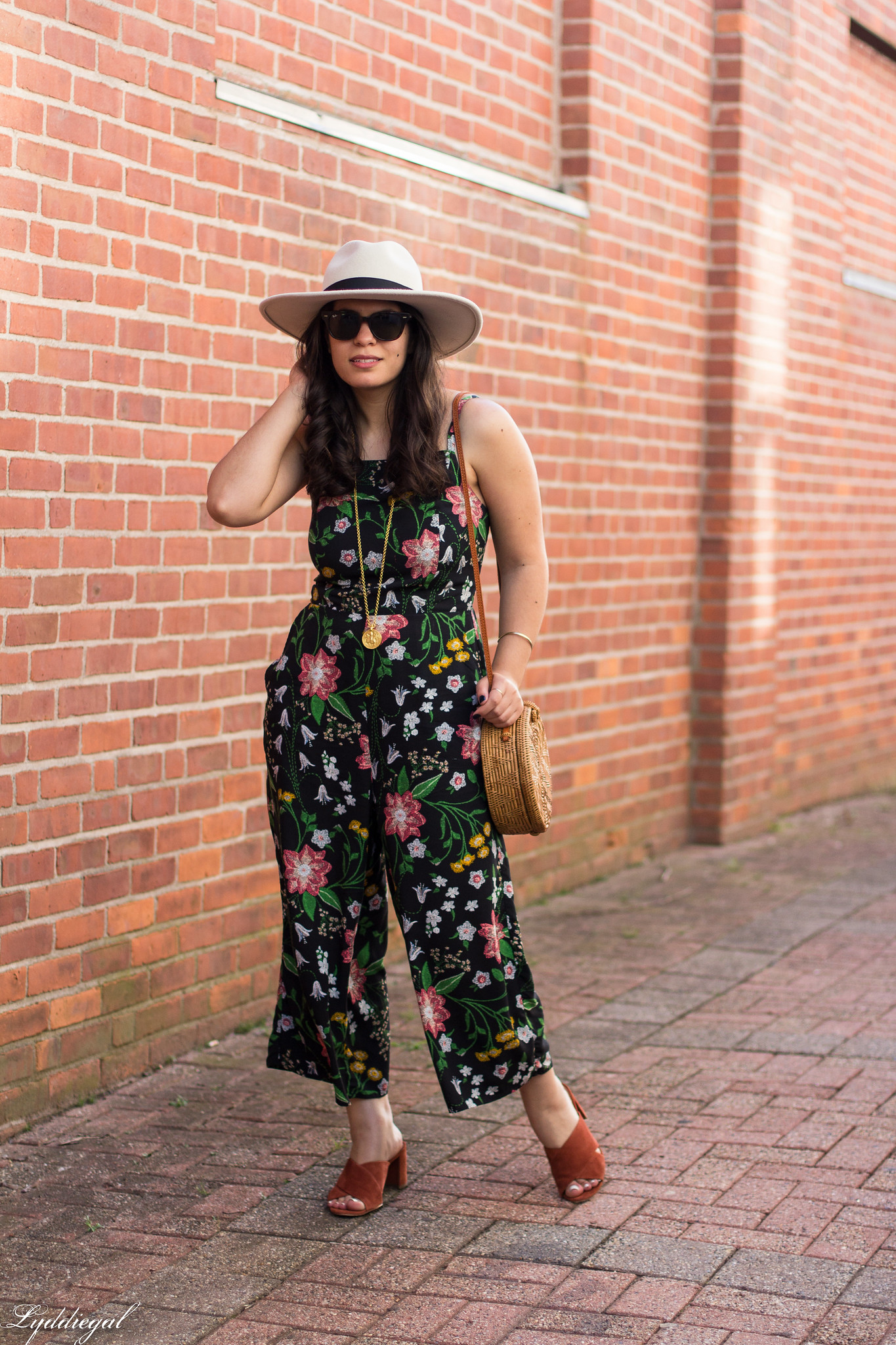 black floral jumpsuit, rust mules, cream fedora, straw bag-3.jpg
