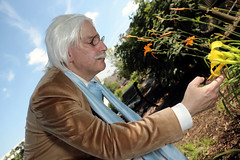 The Doctor examining an unusual flower